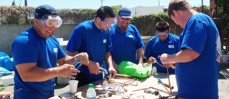 A group of Brownson Technical School Students working outside on a project