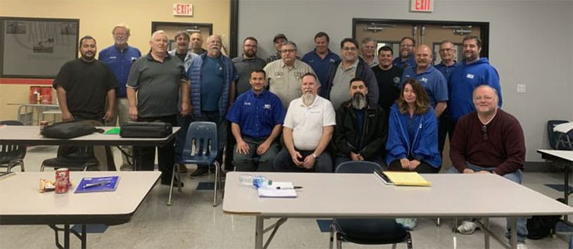 HVACR educators and trainers posing together for a group photo.